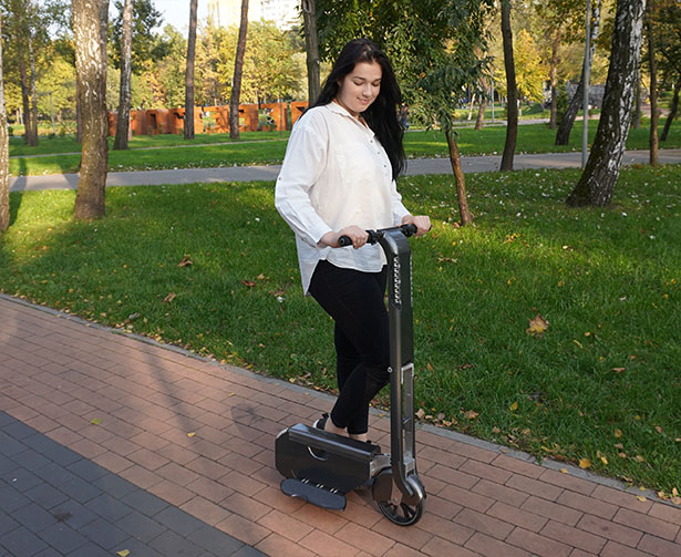 BooZter Folding Electric Scooter That Fits Into Your Backpack by WheelKinetic