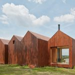 Small Cottage Near a Pond Was Inspired by Traditional Fisherman's Cabins