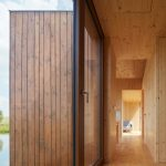 Small Cottage Near a Pond Was Inspired by Traditional Fisherman's Cabins by Studio A111
