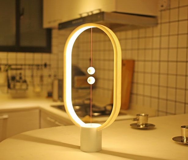 Heng Balance Lamp with Magnetic Mid-Air Switch by Li Zanwen