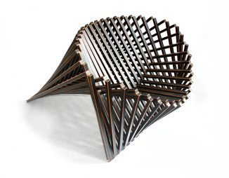 A Flat Wooded Surface that Rises Into a Chair – A Sculptural Beauty!
