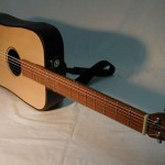 Traveler's Guitar That Folds In Half by Shlomi Daniel and Uri Nir