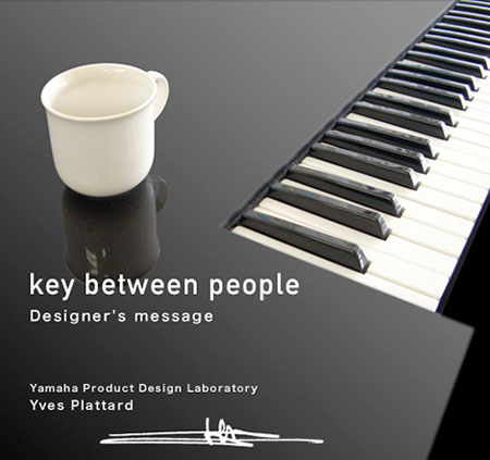 yamaha piano key between people